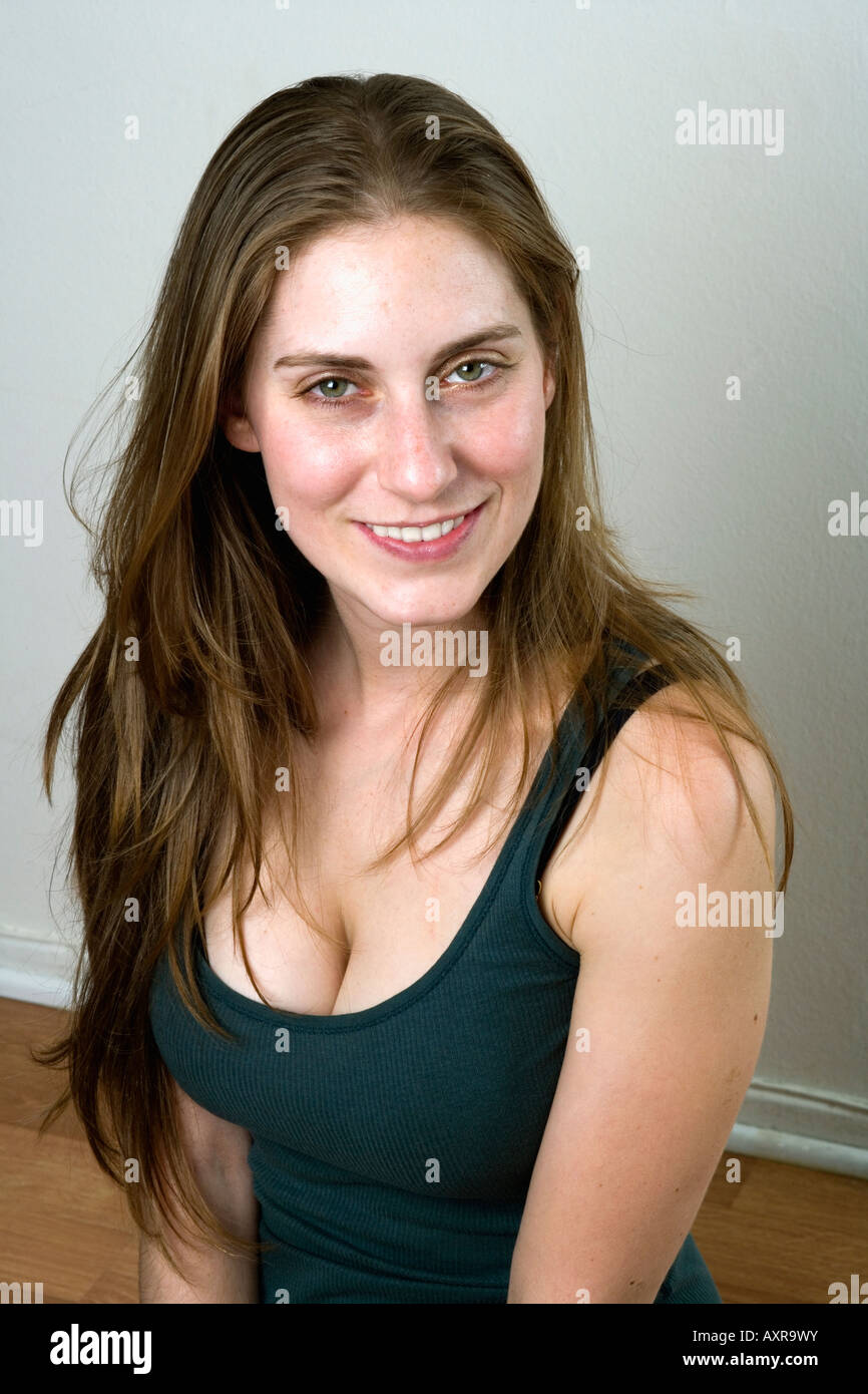 Late twenties female poses for portrait at home - Stock Image