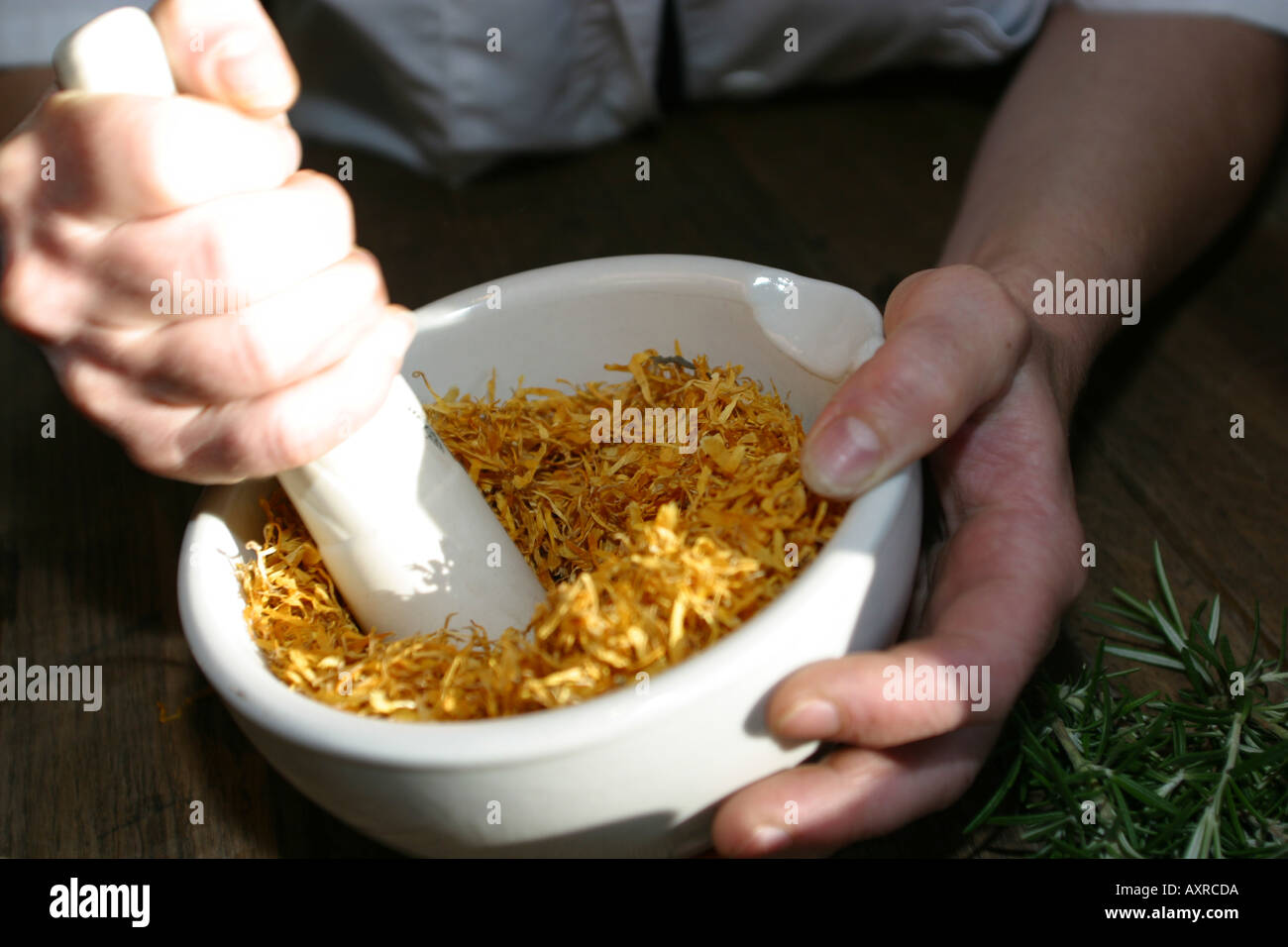 grinding ingredients for hand made soap in pestel and mortar - Stock Image