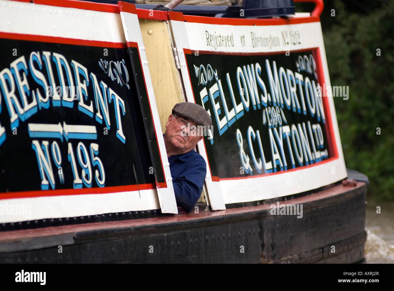 Steam powered narrowboat President on the canal, historic Fellows, Morton & Clayton Ltd. No. 195 Stock Photo