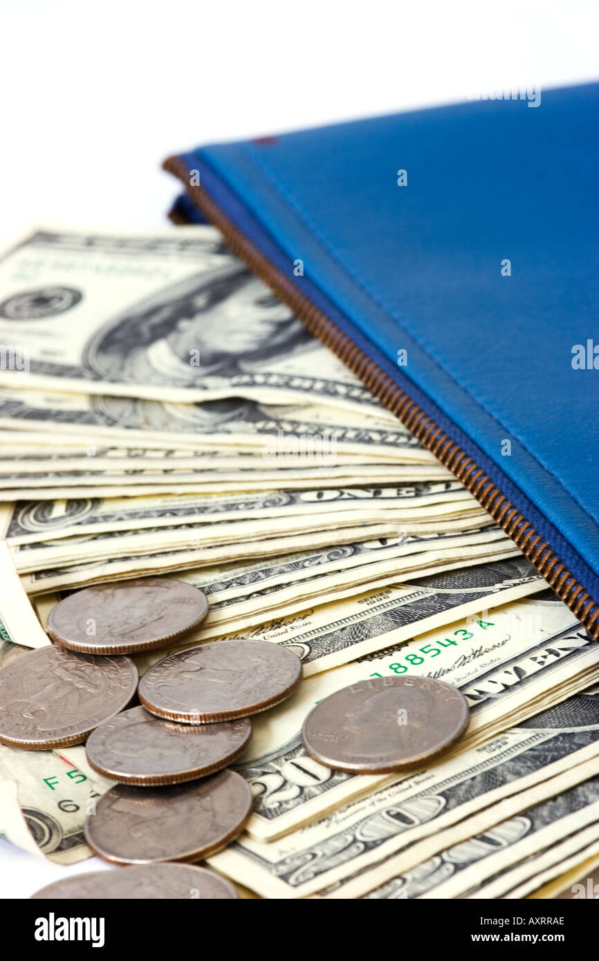 American dollars and coins sticking out of a zippered bank money bag - Stock Image