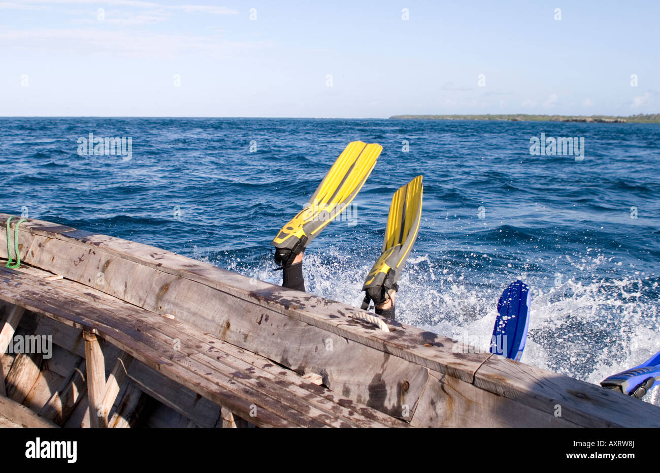 Scuba divers entering the water from a boat in Chole Bay Mafia Island Tanzania - Stock Image