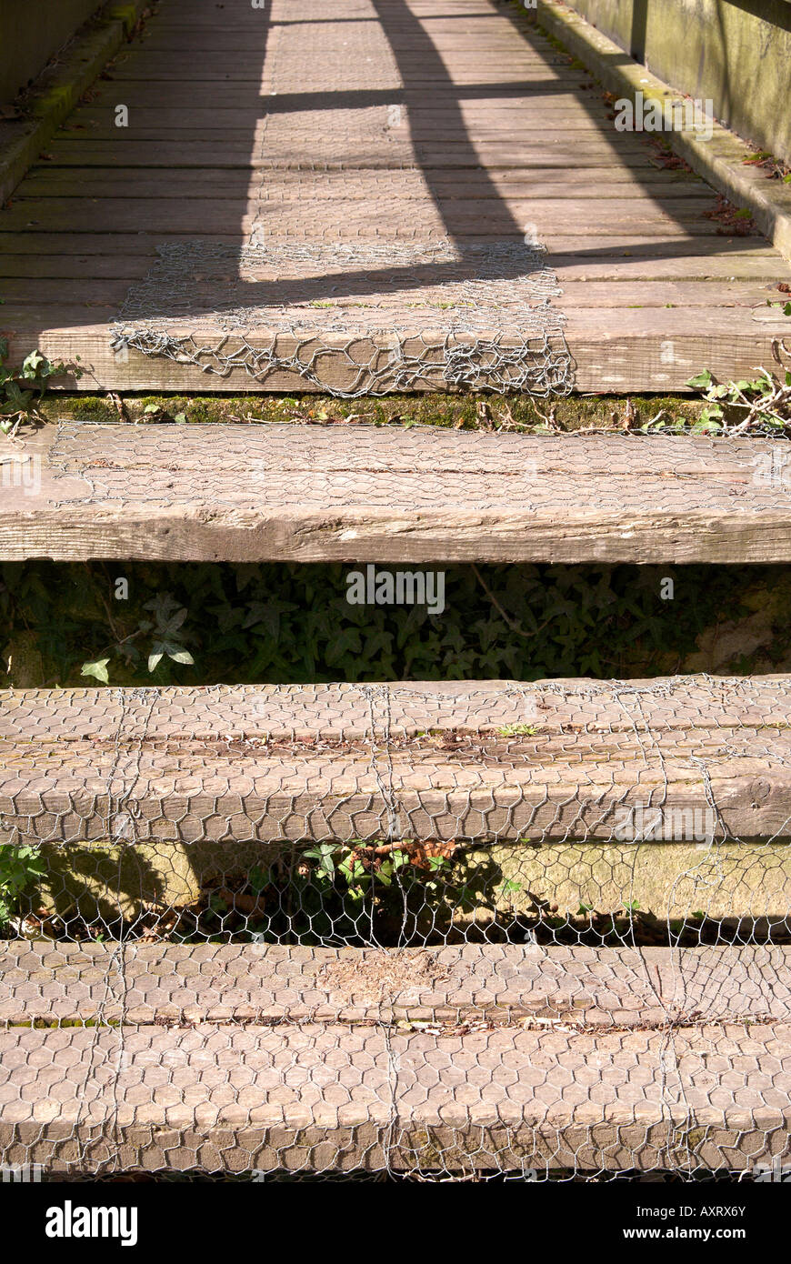 Wooden Steps To A Small Footbridge With Chicken Wire Used To Provide