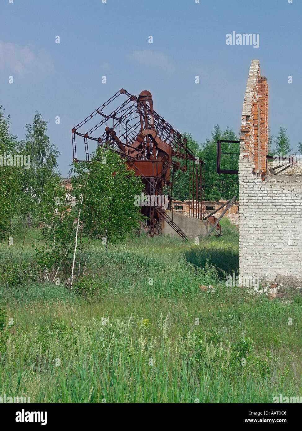 Derelict farm and agricultural machinery in Chernobyl exclusion zone near Ukraine Belarus border - Stock Image
