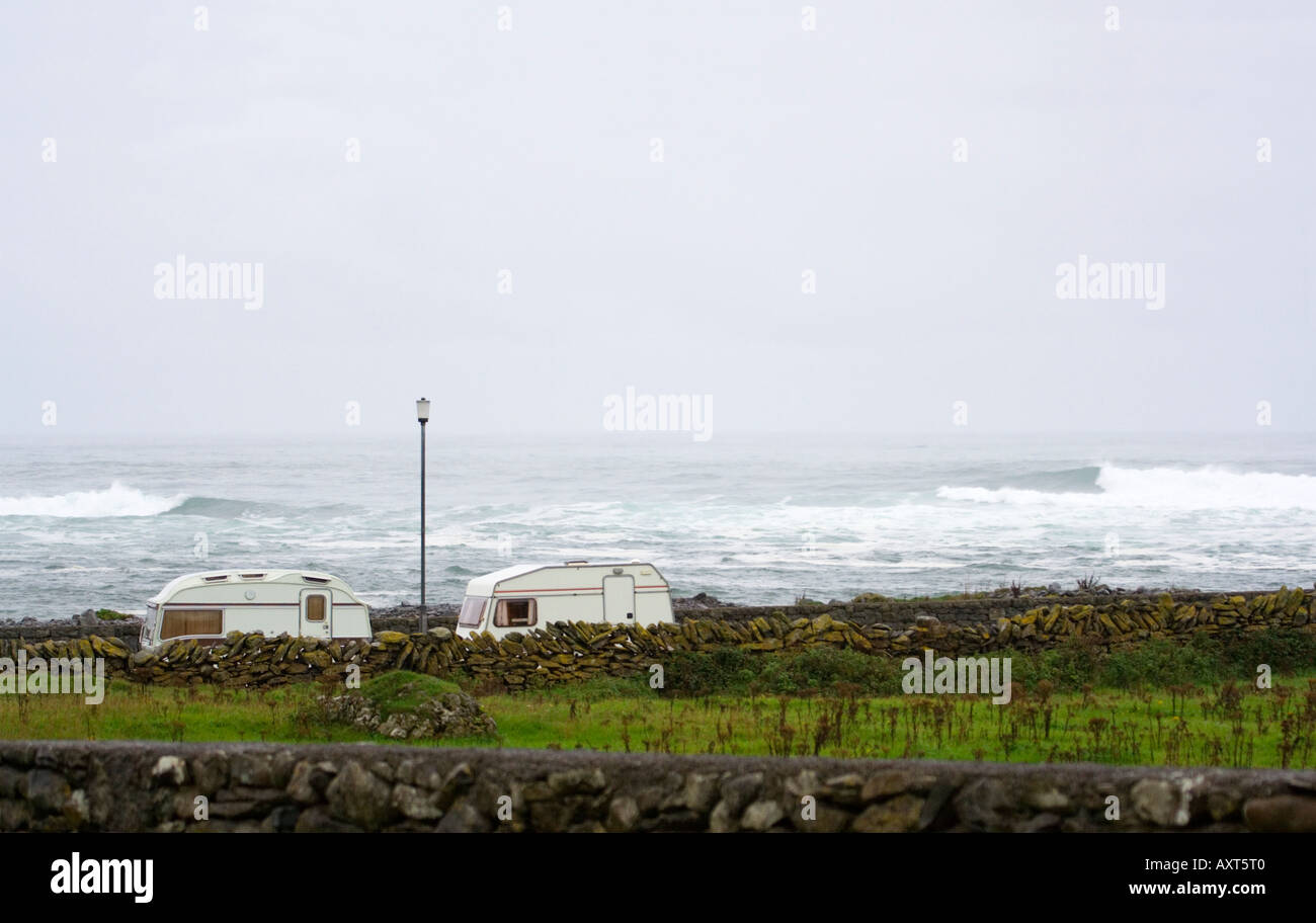 Caravans. Doolin. West coast of Ireland. Stormy weather. Bad weather. Dry stone walls. Summer - Stock Image