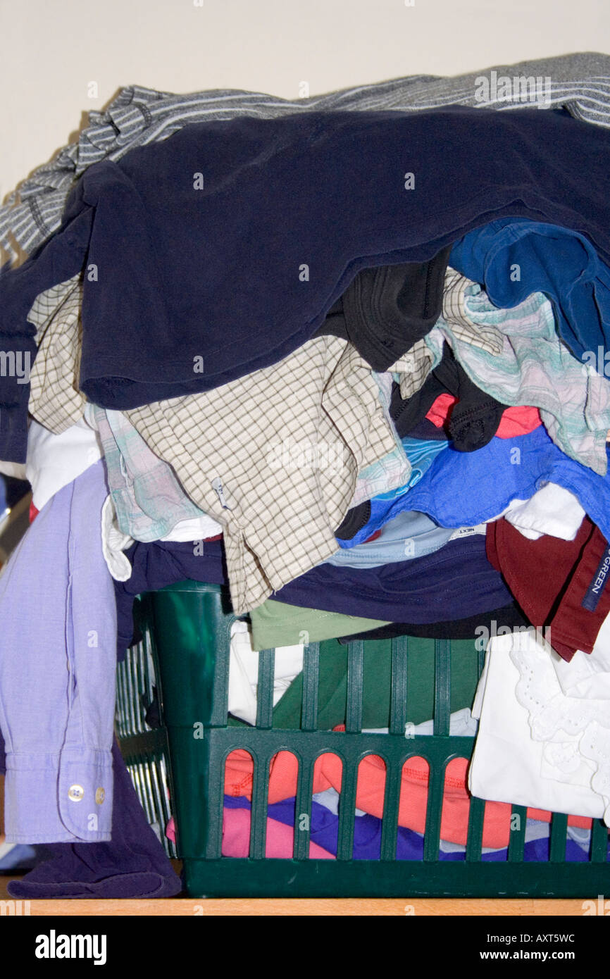 A bundle of clothes in a laundry, washing basket. - Stock Image