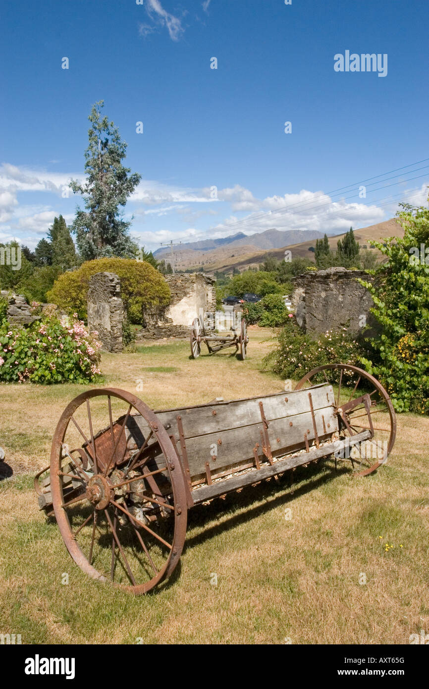 Garden With Old Wagon Wheels Stock Photo Alamy