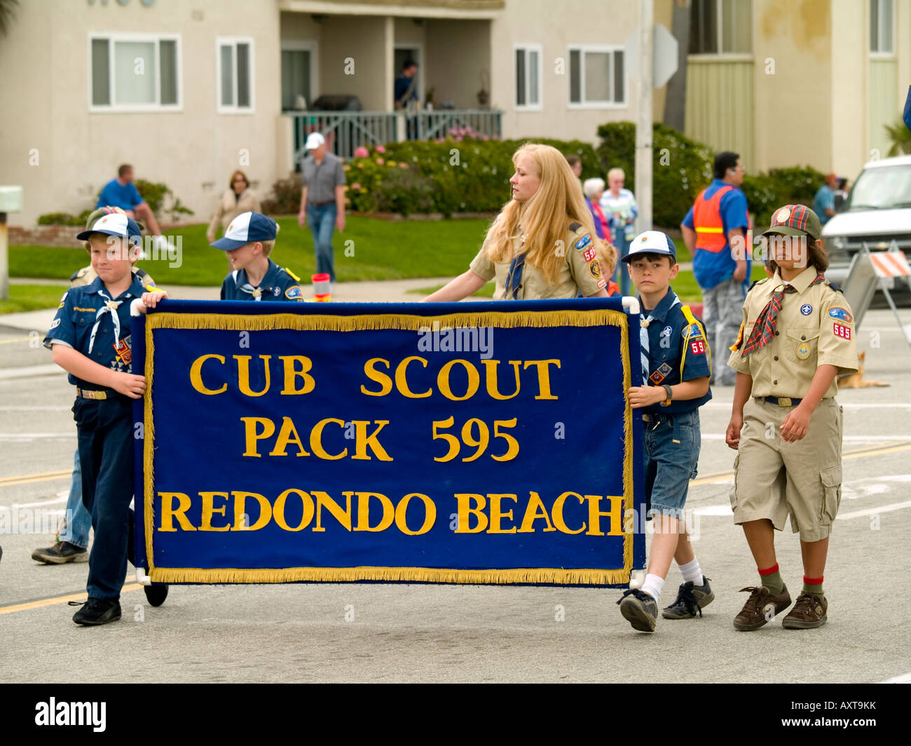 Redondo Beach Cub Scouts carry banner in Memorial Day parade