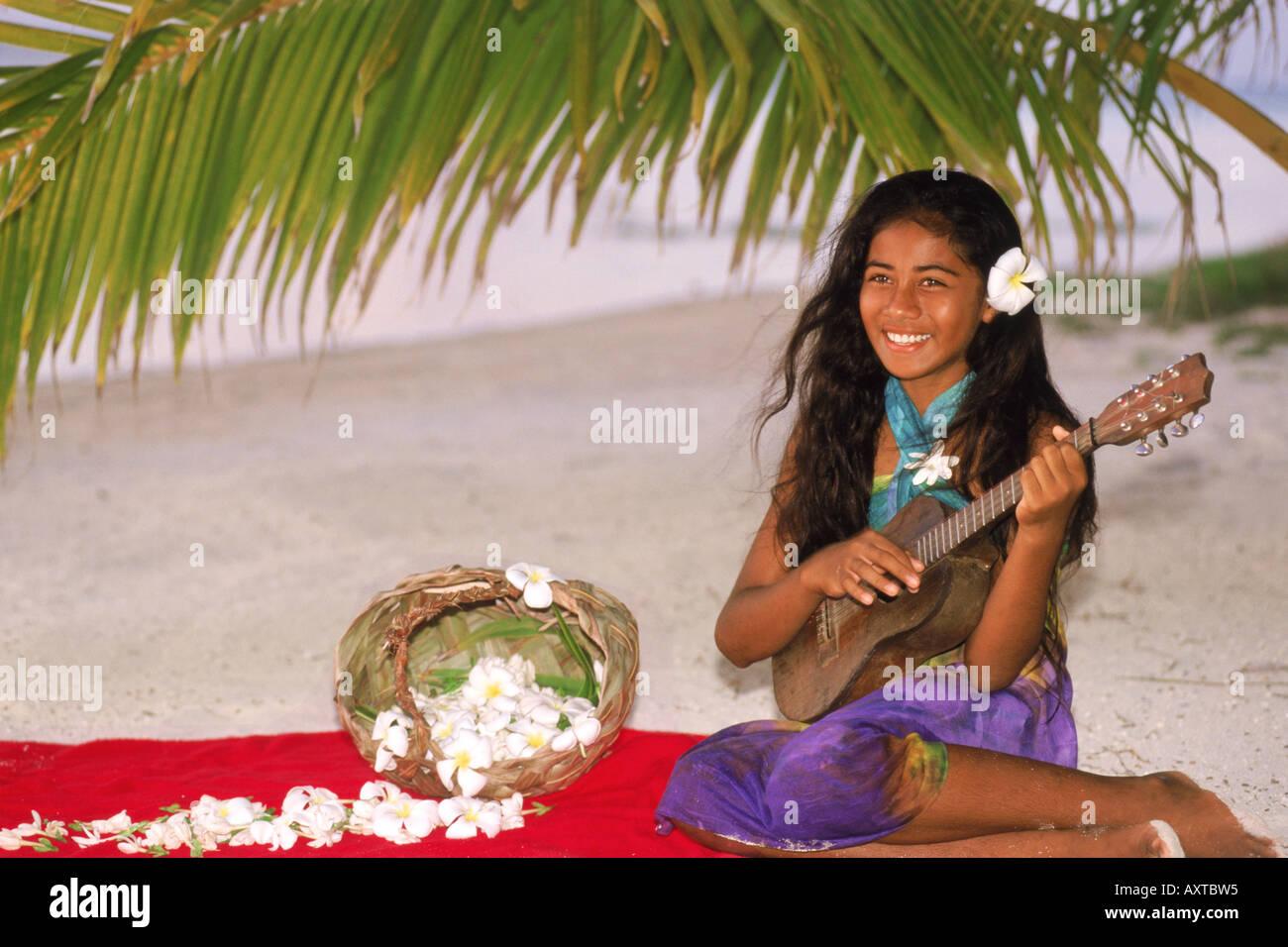 Polynesian girl sitting on Aitutaki beach under plam frond playing ukelele - Stock Image  sc 1 st  Alamy & Native Costume Female Sit Sitting Stock Photos u0026 Native Costume ...