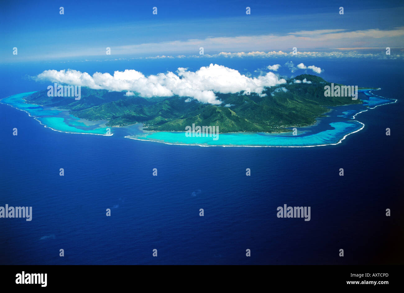 Aerial view of Moorea Island in French Polynesia swimming between blue skies and blue South Pacific - Stock Image