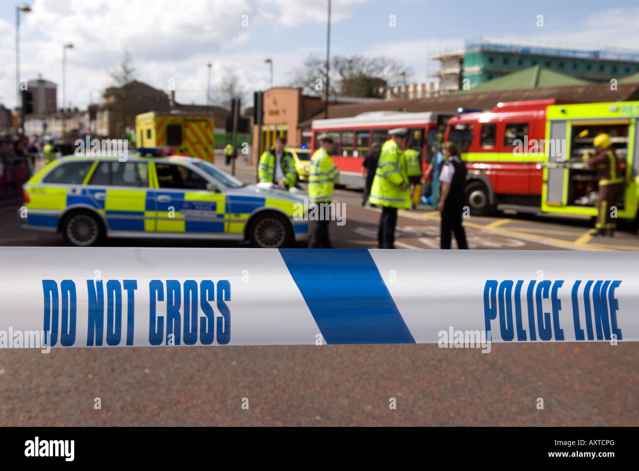 Police officers and cordon sign at the scene of a road traffic accident (RTA), Hounslow, Middlesex, UK. 30th March - Stock Image