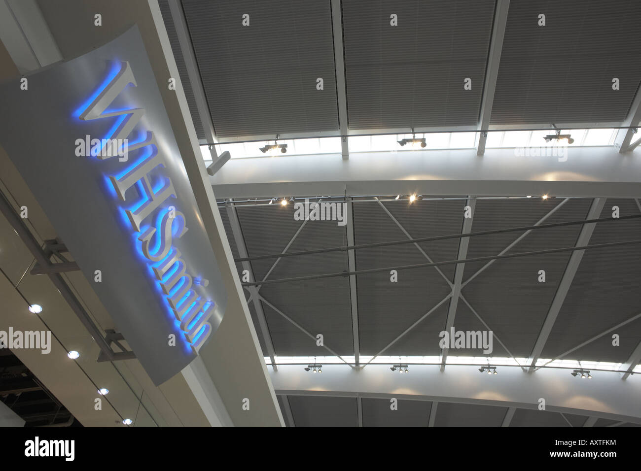 Looking upwards to WH Smiths retail sign in landside Departures area newly opened London Heathrow Airport's - Stock Image