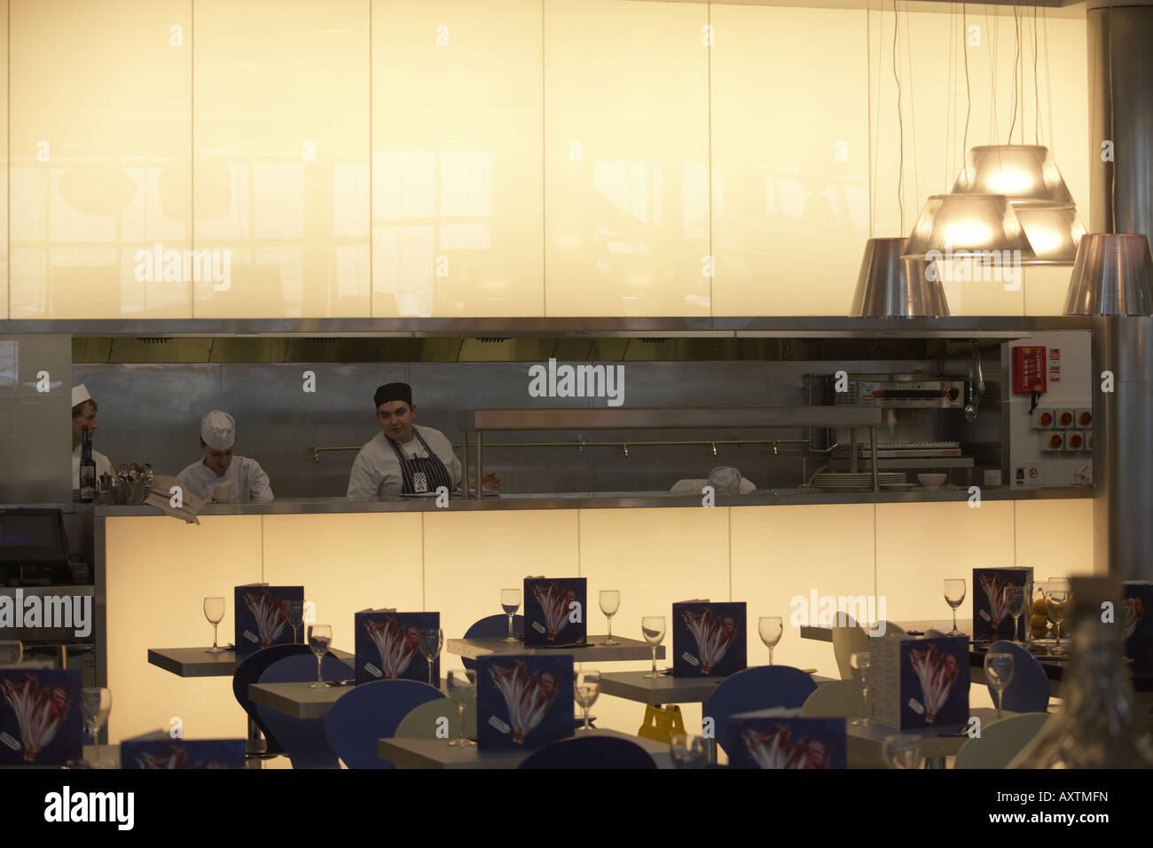 Chefs inside Carluccio's retail restaurant in landside Departures area of London Heathrow Airport's Terminal - Stock Image