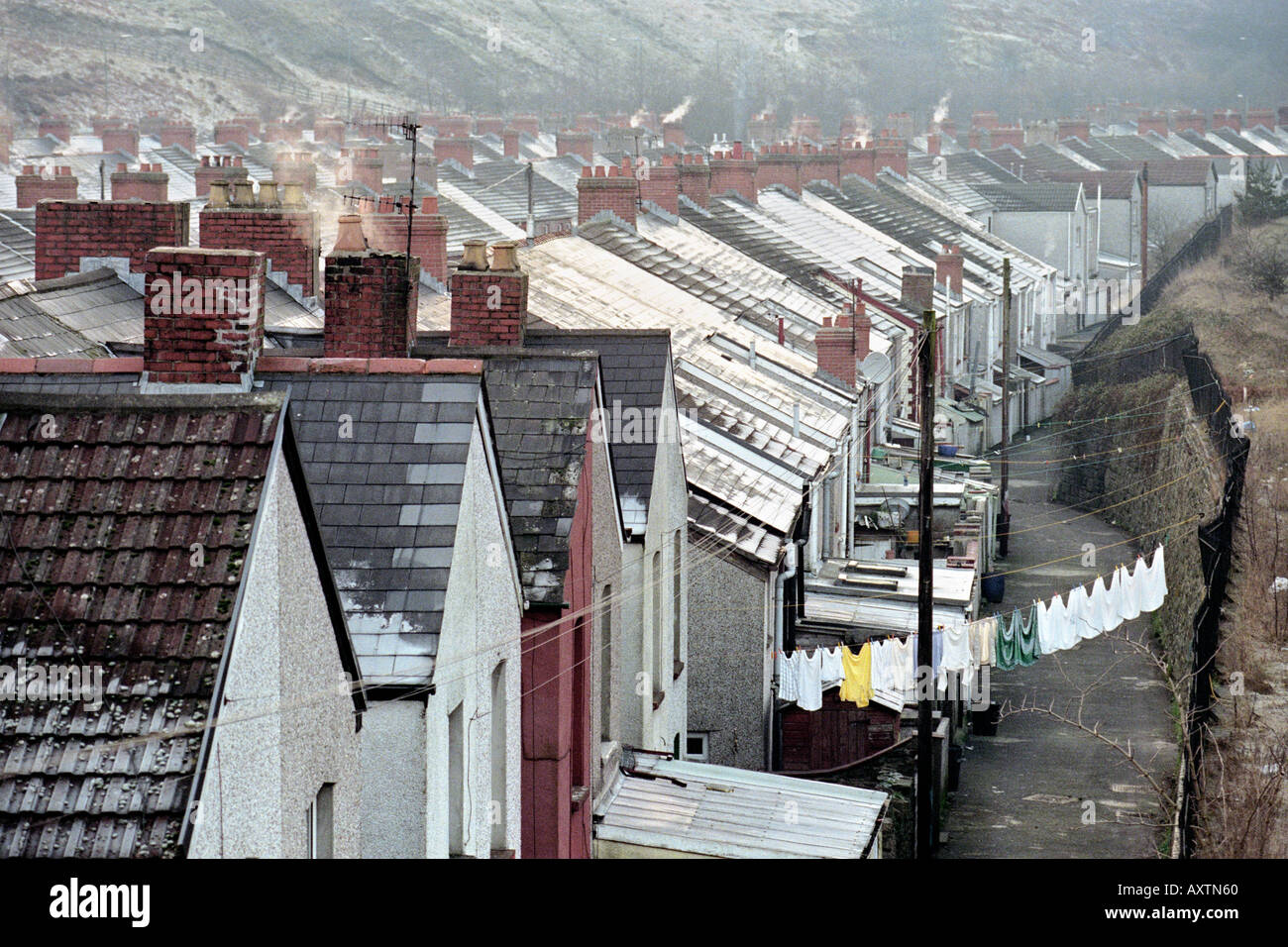 Former mining village of Llanhilleth South Wales UK GB on a cold frosty winters day with washing drying on the clothes line - Stock Image