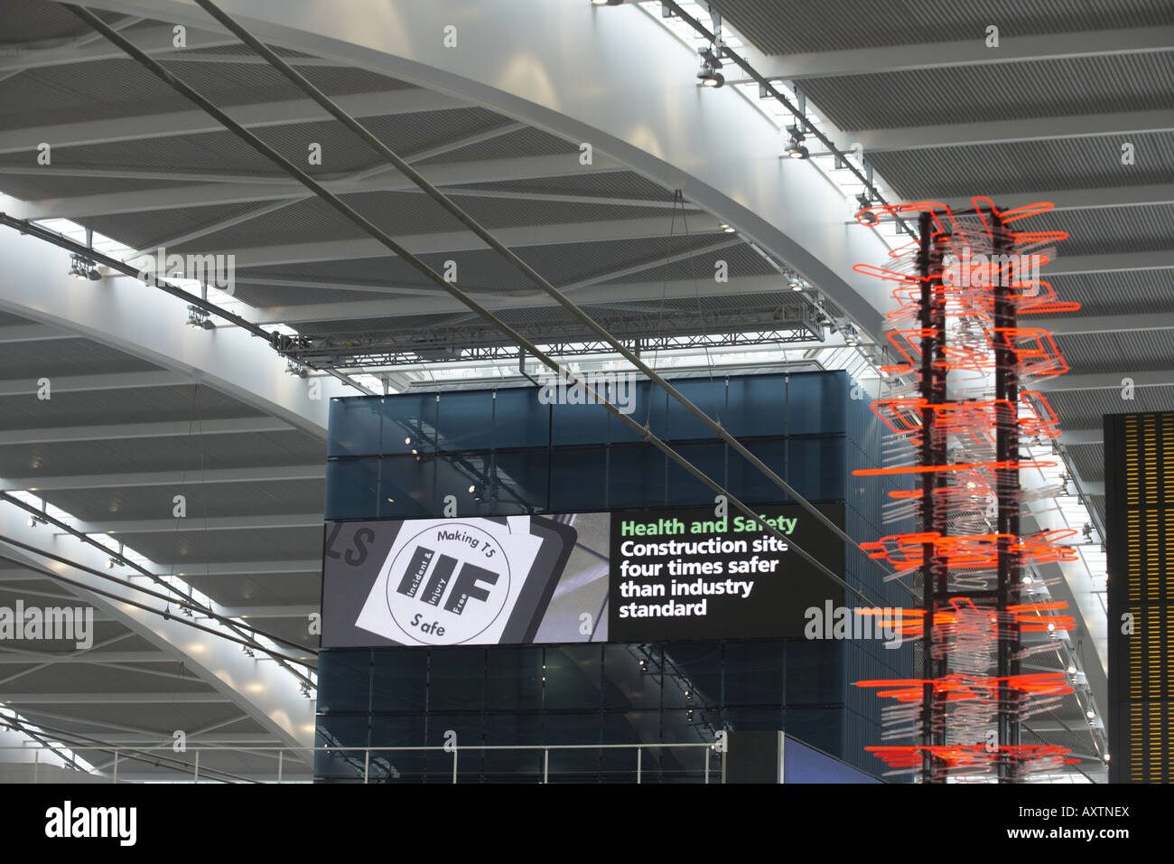 Looking up to the Nokia information screen and high roof of newly opened London Heathrow Airport's Terminal - Stock Image