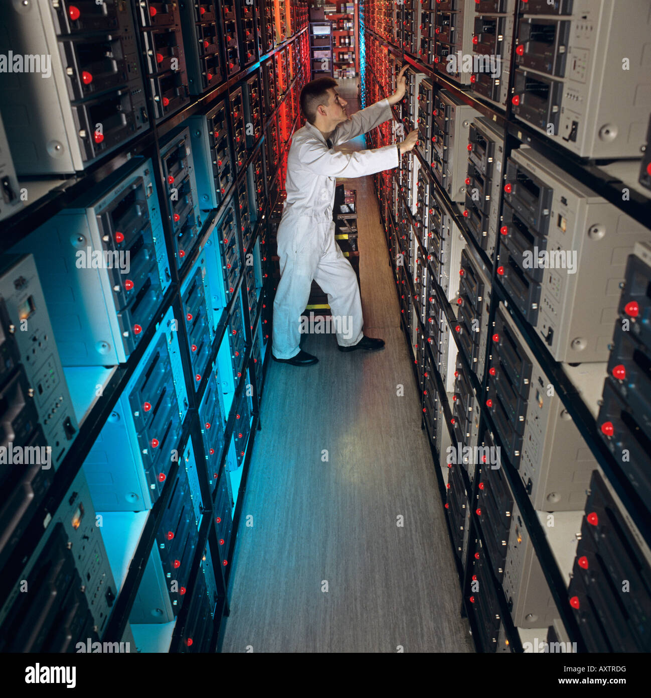 Mass production in duplication laboratory of movie films on to VHS video tape for distribution in retail market - Stock Image