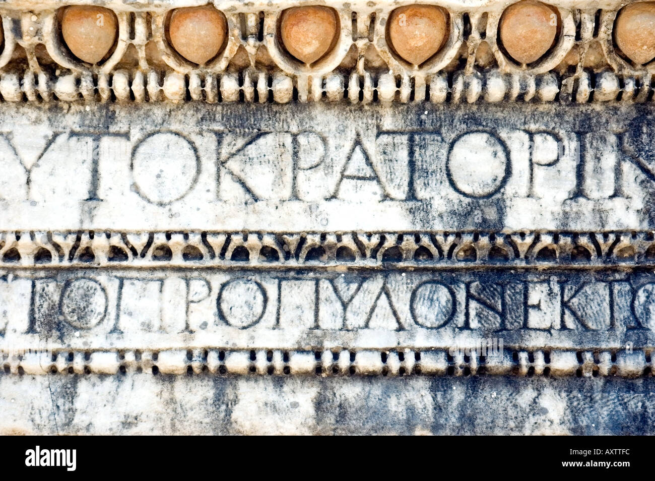 An intricately carved stone frieze depicting Greek writing and script design, in the city of Ephesus, Turkey. DSC_6701 - Stock Image