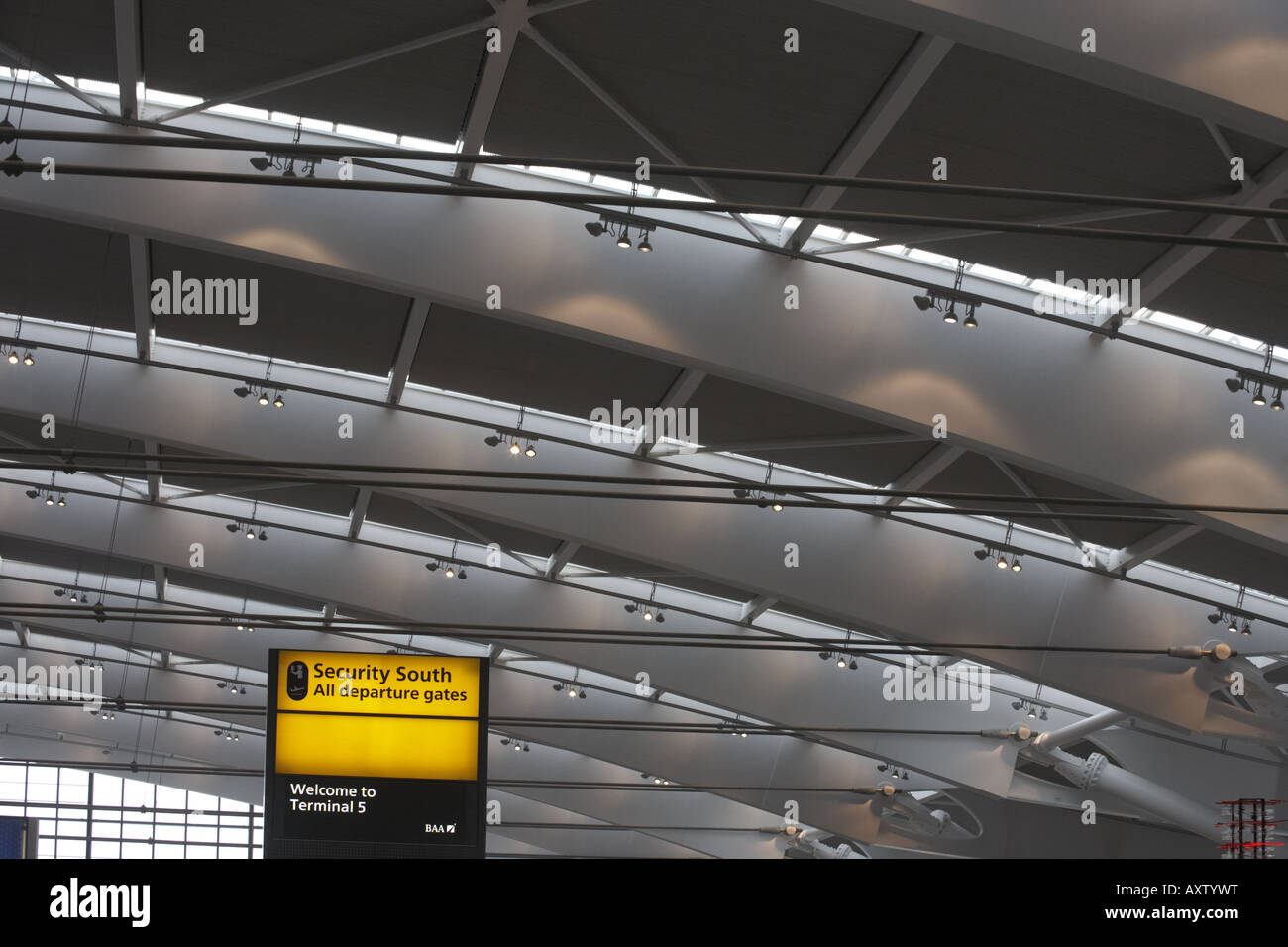 Looking upwards to security and departures sign in newly opened London Heathrow Airport's Terminal 5 building - Stock Image