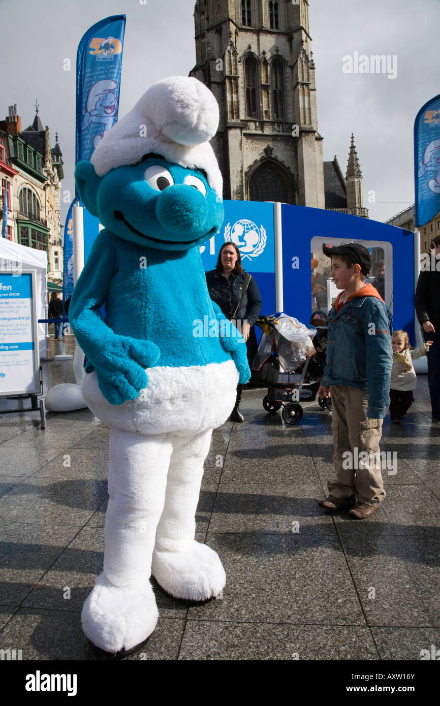 A Smurf character campaigns for UNESCO programme in Saint Bavos sq. outside St Bavos Cathedral, Ghent. Belgium - Stock Image