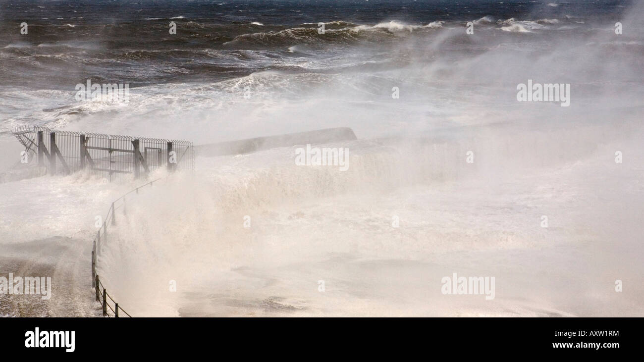 A violent and severe gale blows waves through the locked gates of Seaham Pier in County Durham - Stock Image