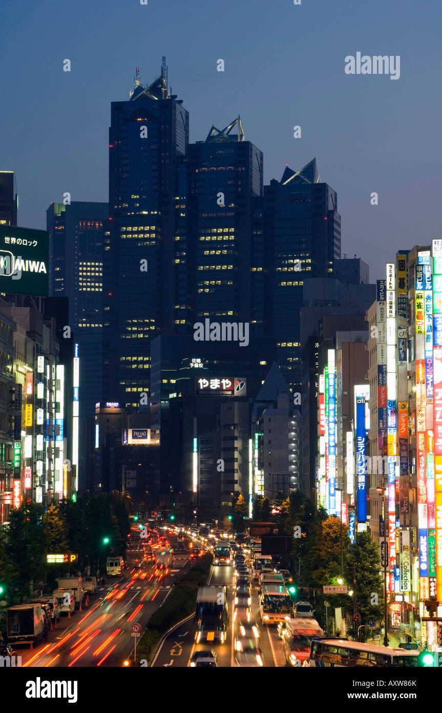 The Park Hyatt Hotel, location of the film Lost in Translation, and busy traffic at night, Shinjuku, Tokyo, Japan, - Stock Image