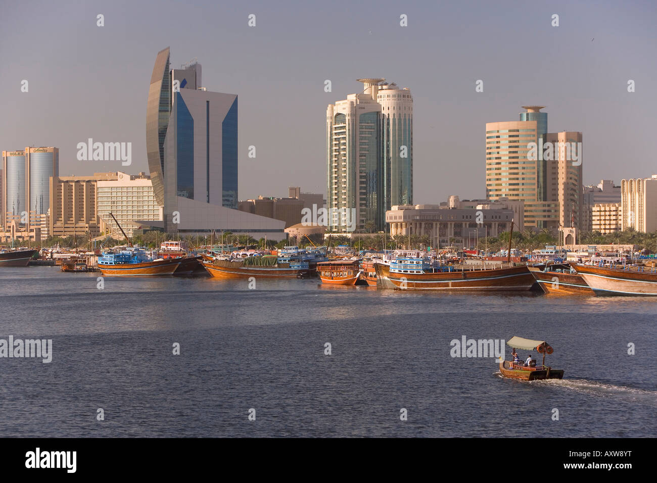 Dubai Creek (Khor Dubai), Dhow Wharfage and Commercial Centre, Deira, Dubai, United Arab Emirates, Middle East - Stock Image