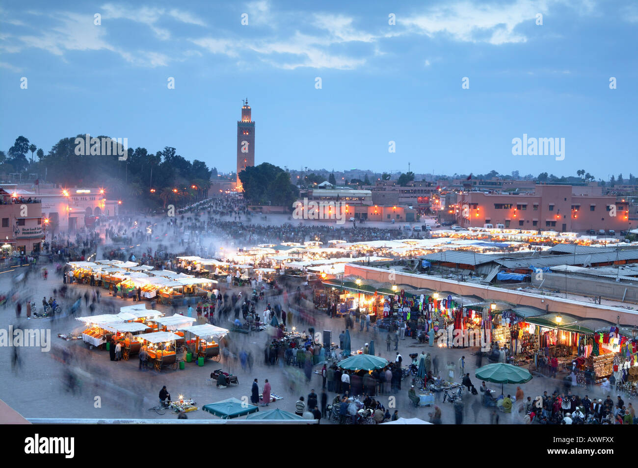 Djemma el Fna square and Koutoubia Mosque at dusk, Marrakech, Morrocco, North Africa, Africa - Stock Image
