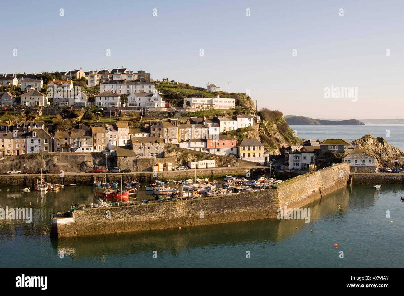 Houses on headland surrounding the old fishing port, Mevagissey, Cornwall, England, United Kingdom, Europe - Stock Image