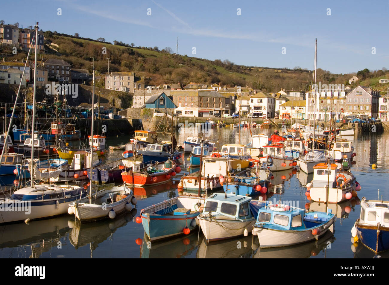 Colourful old wooden fishing boats in the harbour, Mevagissey, Cornwall, England, United Kingdom, Europe Stock Photo