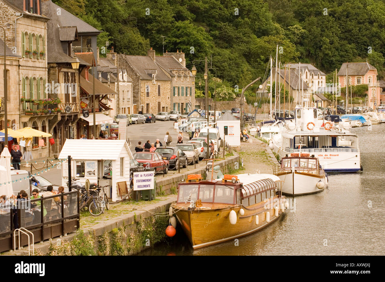Boats on the River Rance and waterfront cafes in Port du Dinan, Brittany, France, Europe - Stock Image