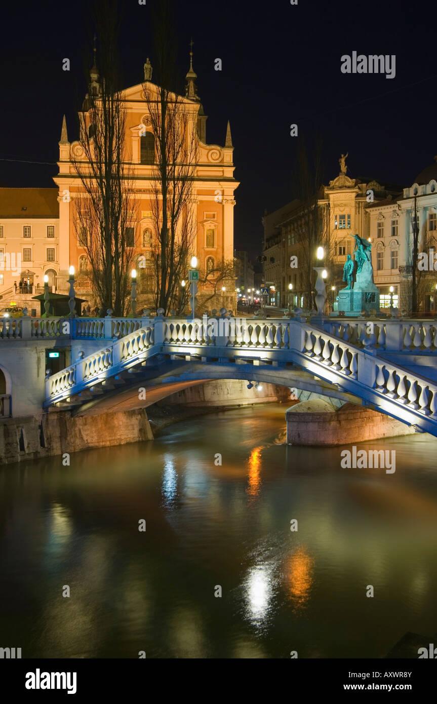 Tromstovje Triple bridge over the River Ljubljanica, Franciscan Church and Preseeren Square at night, Ljubljana, - Stock Image