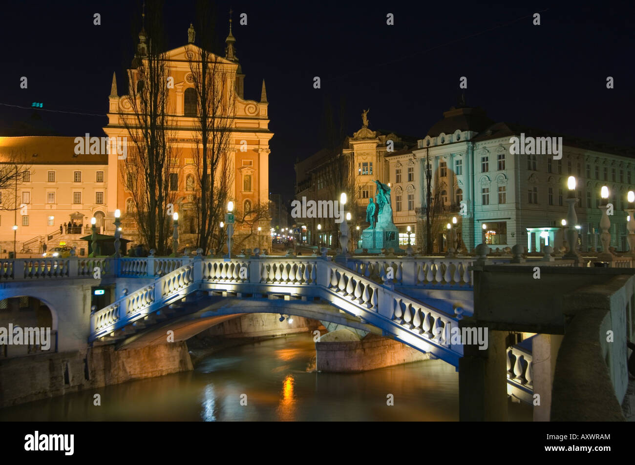 Tromstovje Triple bridge over the River Ljubljanica, Franciscan Church and Preseeren Square at night, Ljubljana, - Stock Image