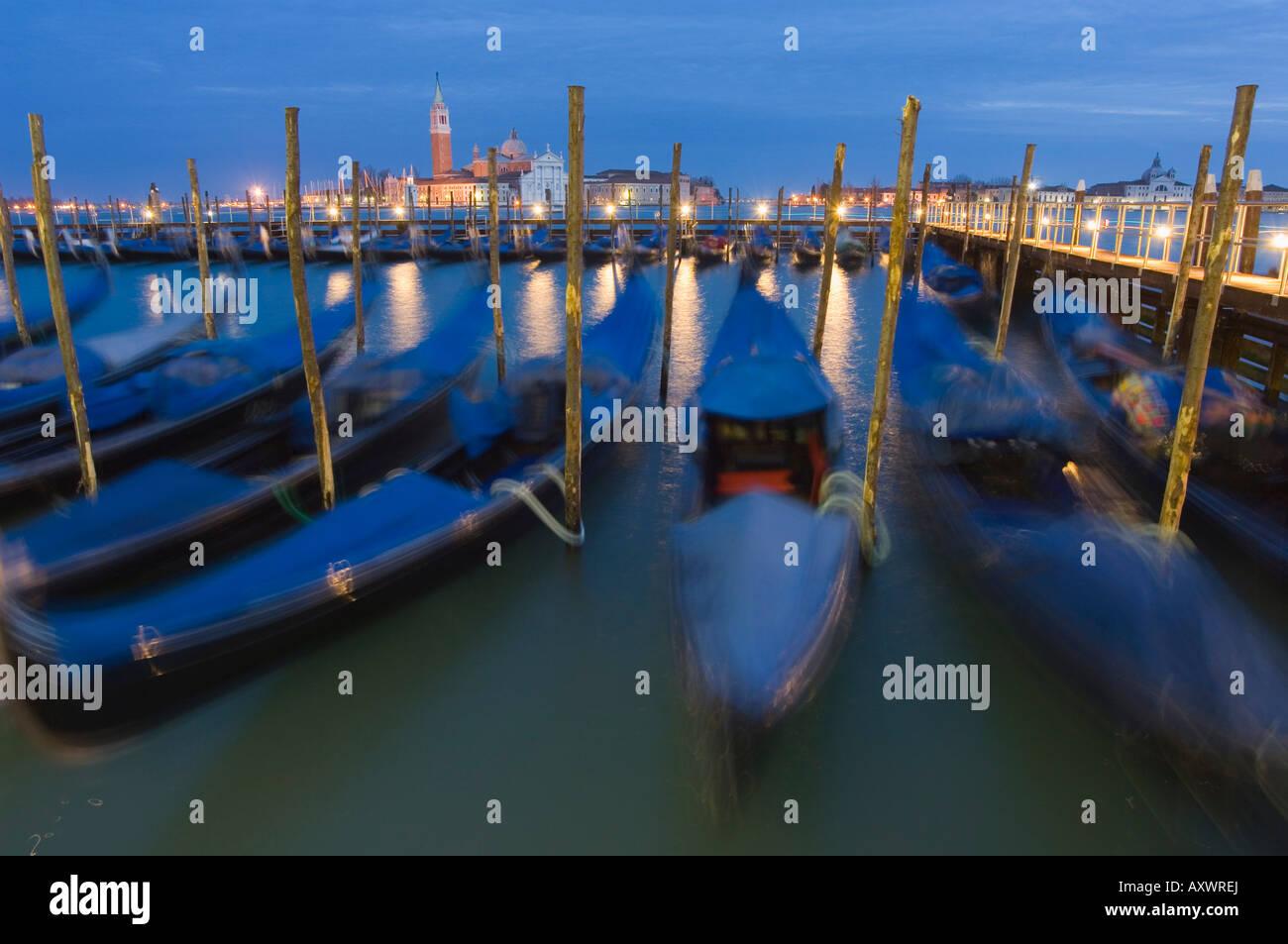 Gondolas on waterfront at night, San Giorgio Maggiore, Venice, UNESCO World Heritage Site, Veneto, Italy, Europe - Stock Image