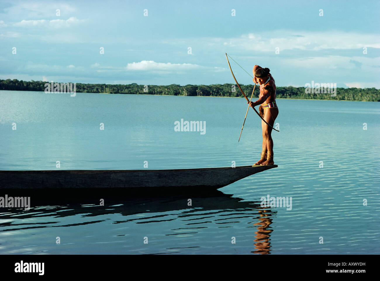Indian fishing with bow and arrow, Xingu, Amazon region, Brazil, South America - Stock Image