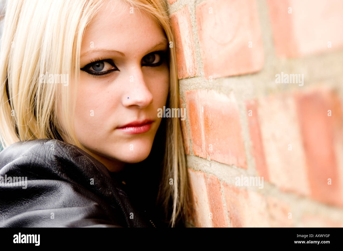 young female model, 17 years old, moody goth look, pressed against a