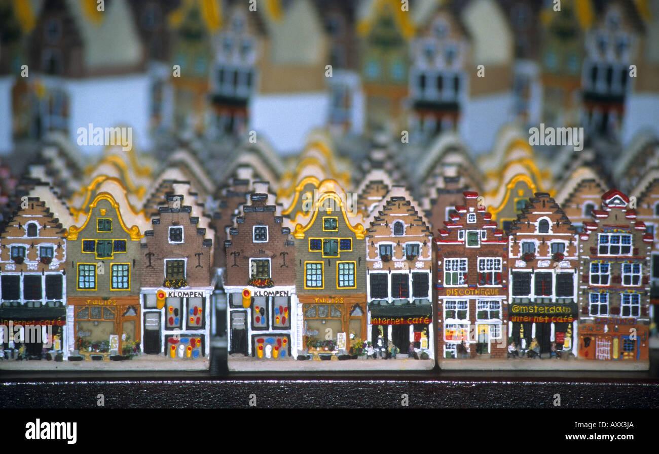 souvenirs at the Dutch model village Zaandijk Zaanstad Koog in Holland include cloga,pottery model houses and costumed dolls - Stock Image