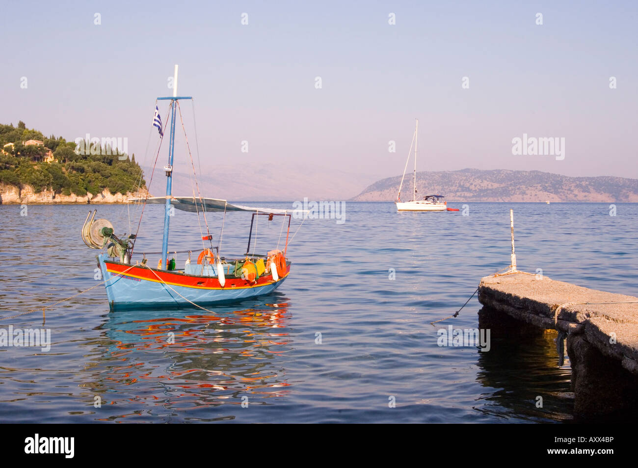 Colourful old wooden fishing boat in Kalami on the northeast coast, Corfu, Ionian Islands, Greek Islands, Greece, - Stock Image