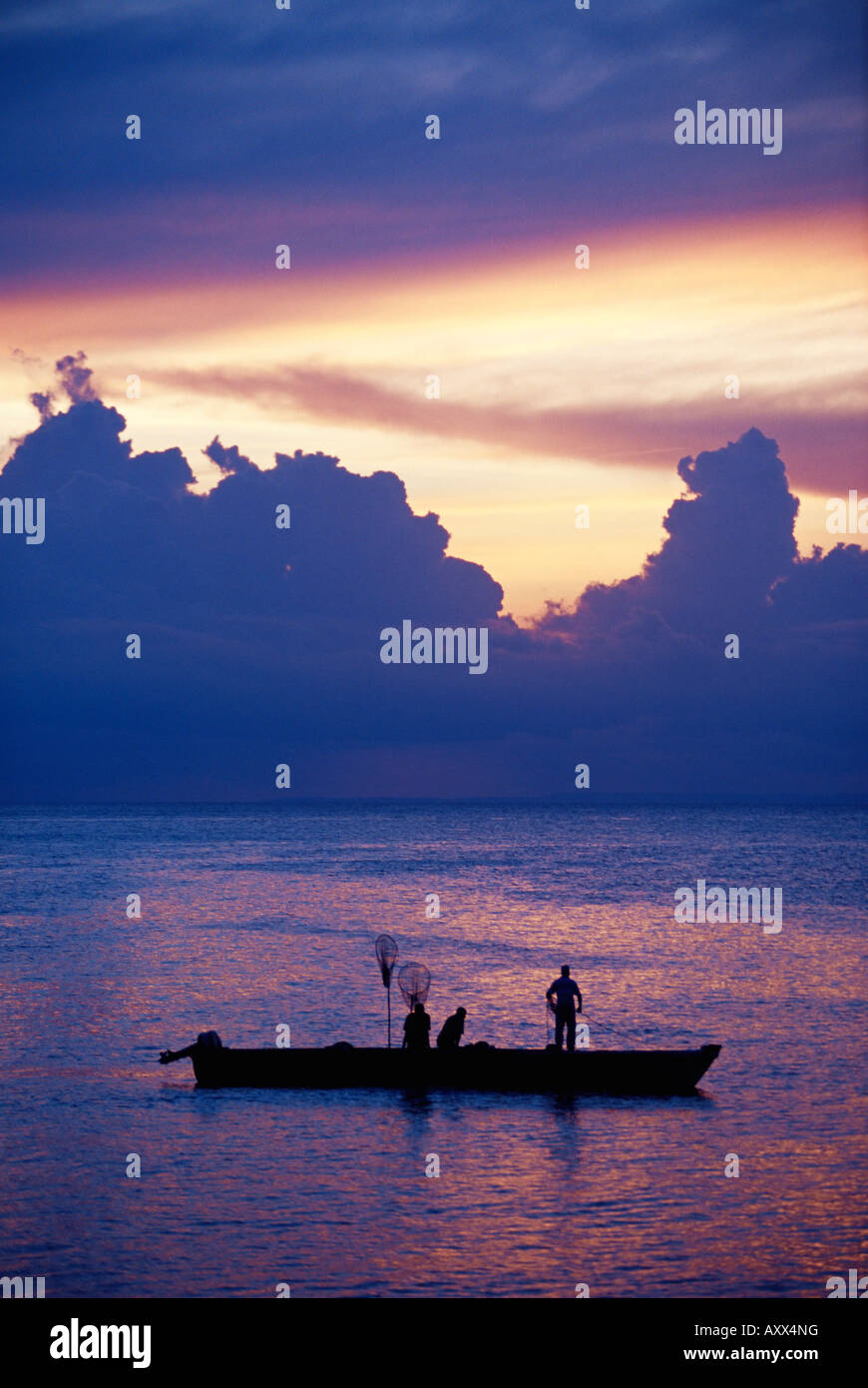 Fishing boat in the Indian Ocean at dawn, island of Zanzibar, Tanzania, East Africa, Africa - Stock Image