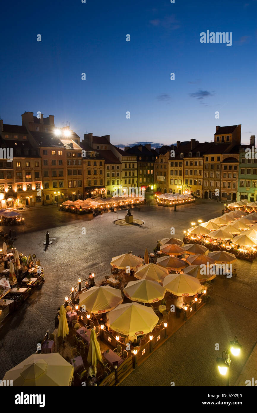 Elevated view over the square and outdoor restaurants and cafes at dusk Old Town Square (Rynek Stare Miasto), Warsaw, - Stock Image
