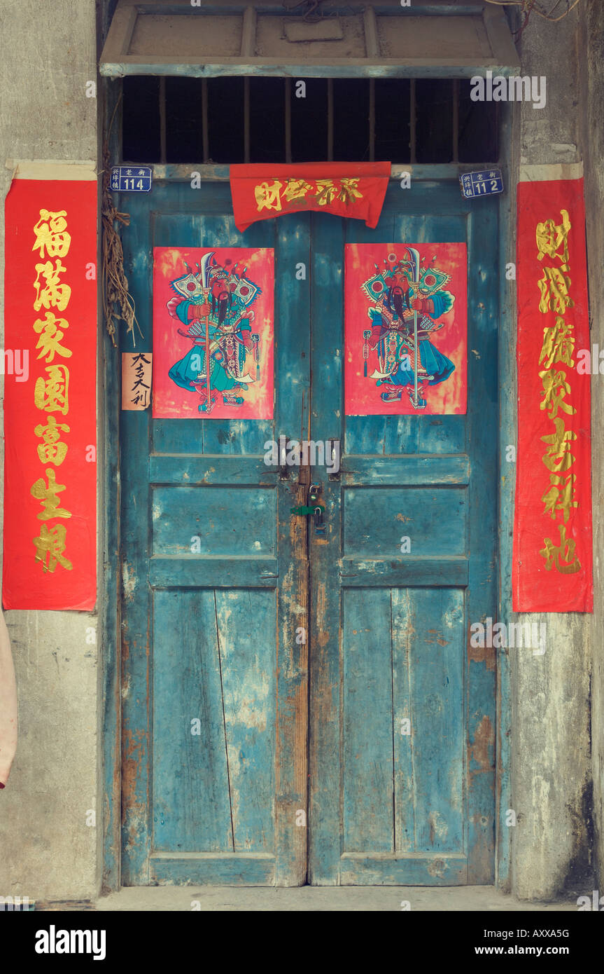 Door with Chinese art and characters, Xingping, Guangxi Province, China, Asia - Stock Image