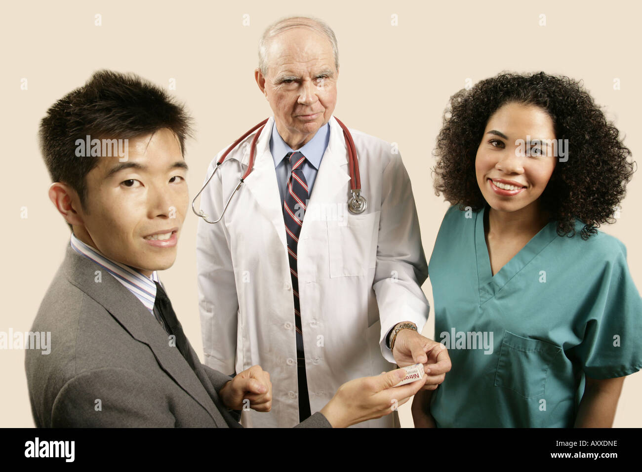 Sales rep agrees to terms with his customer, the chief medical office of the clinic (played by models). - Stock Image