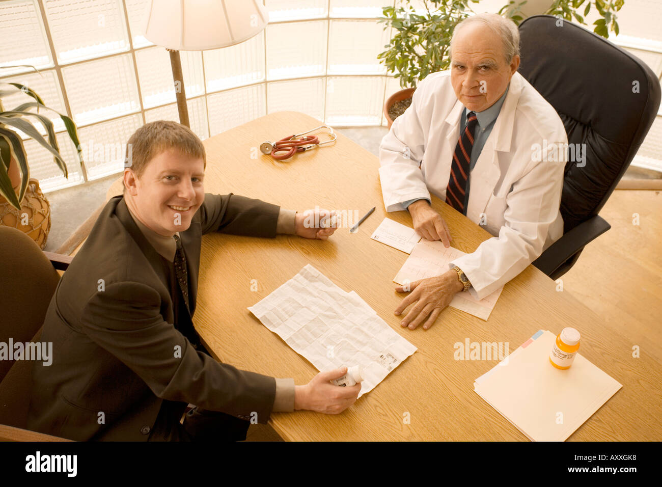 Doctor Meets With Drug Rep Pharmaceutical Representative Stock