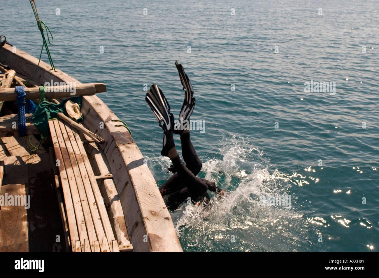 Scuba diver entering water in Chole Bay off Mafia Island Tanzania - Stock Image