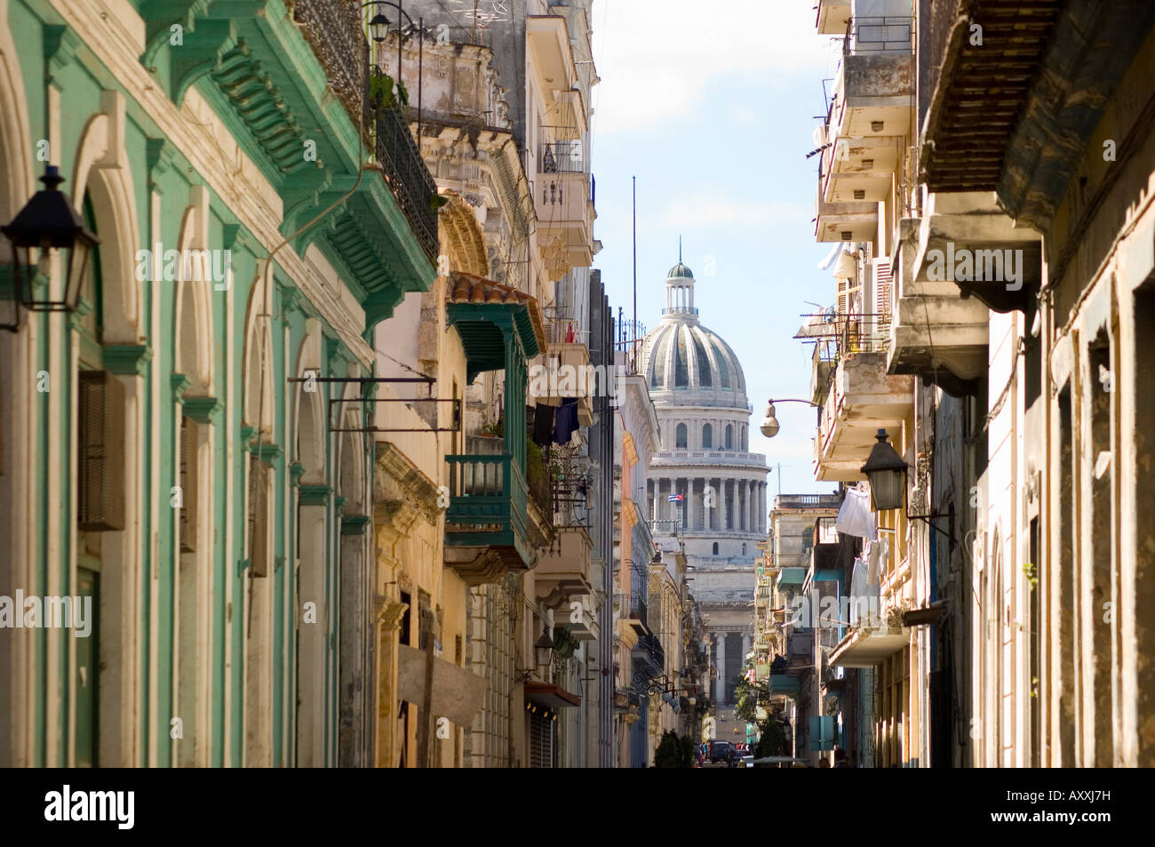 A view of the Capitolio seen through the streets of Habana Viejo (old town), Havana, Cuba, West Indies, Central Stock Photo
