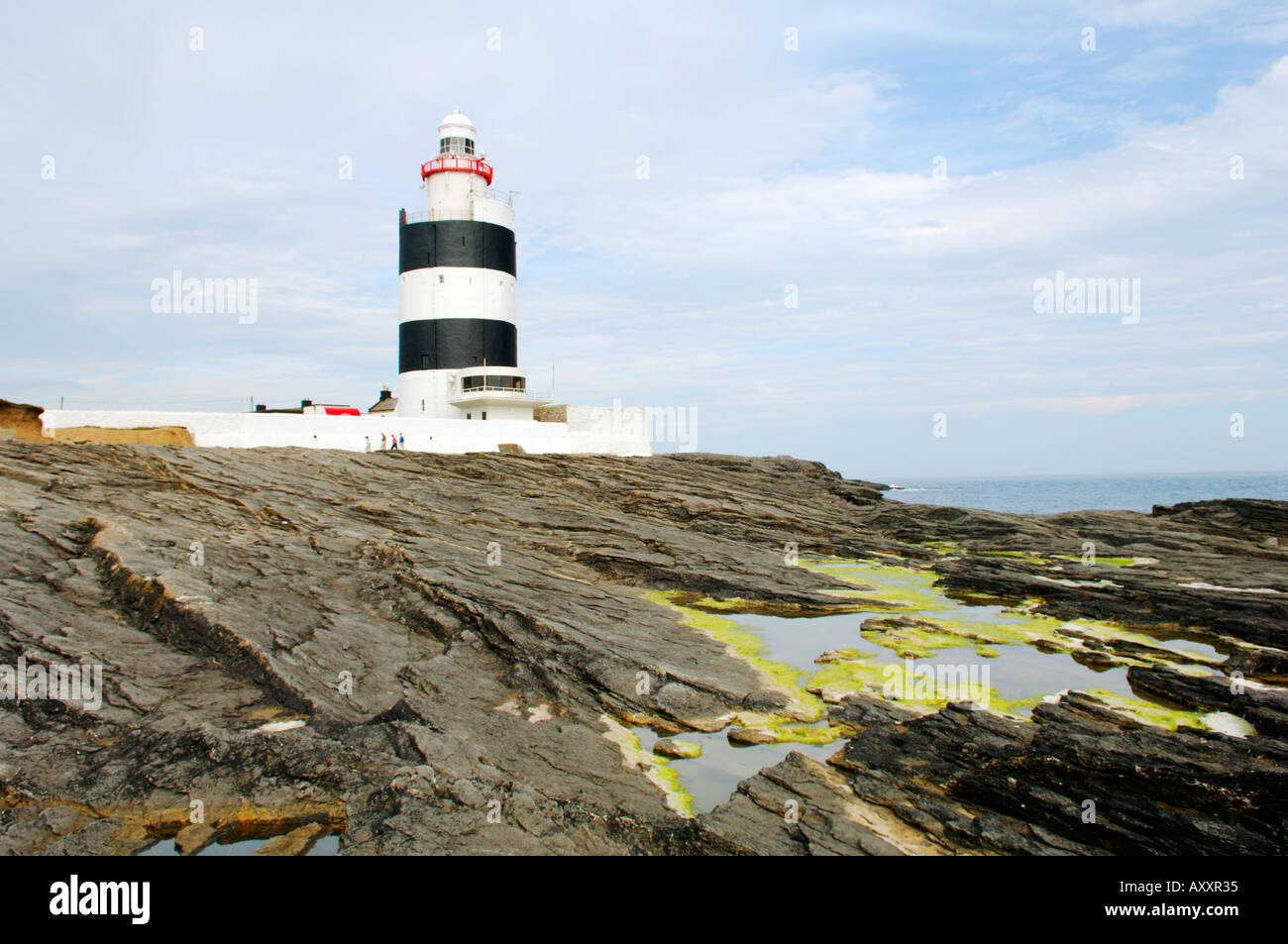 Hook Head lighthouse at the mouth of the River Barrow and Waterford Harbour in County Wexford Ireland dates from the 13th C. - Stock Image