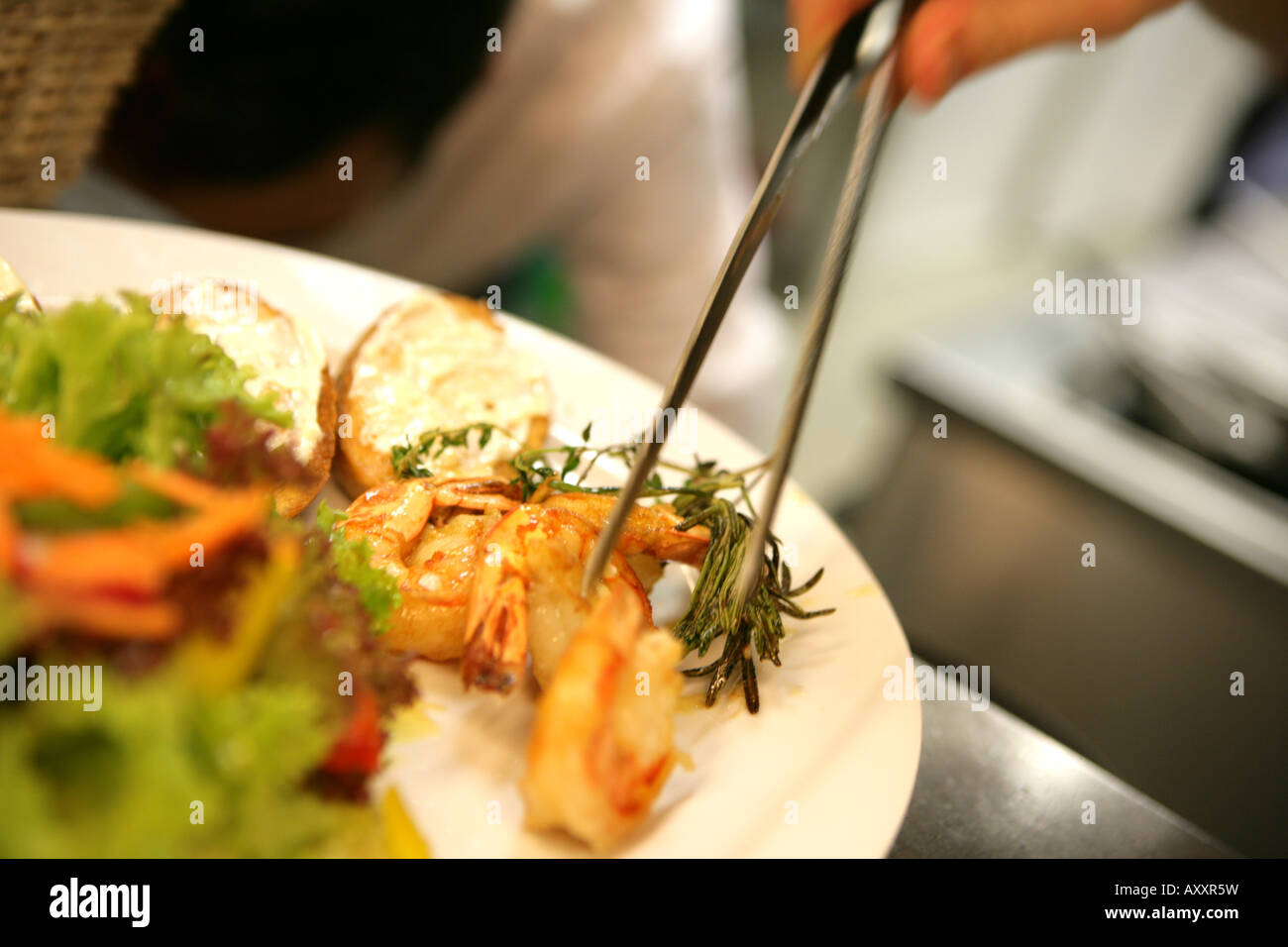Kitchen of a Restaurant Decoration of plates with a s dish seafood plate & Kitchen of a Restaurant Decoration of plates with a s dish seafood ...