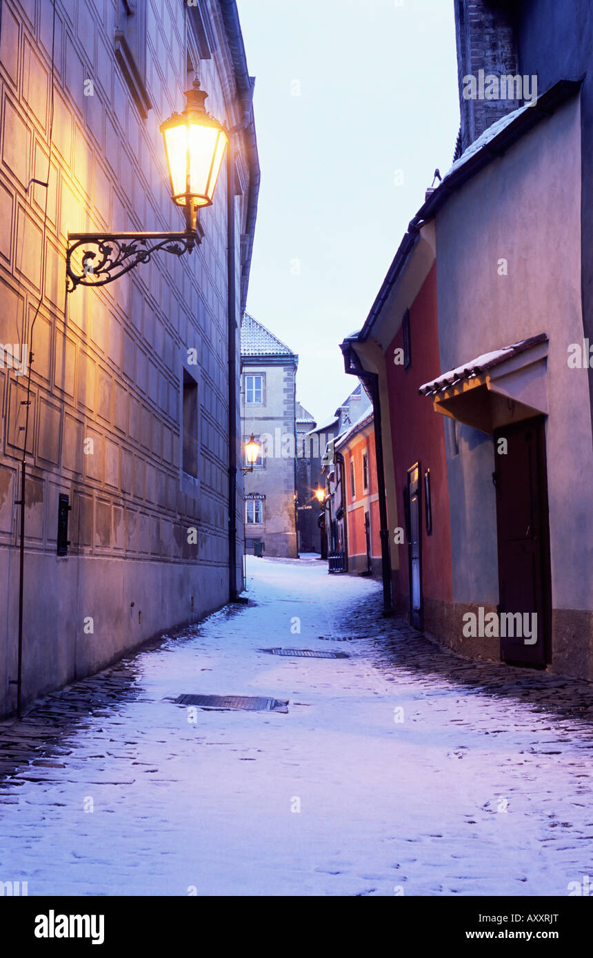 Snow covered 16th century cottages on Golden Lane (Zlata ulicka) in winter twilight, Hradcany, Prague, Czech Republic, - Stock Image