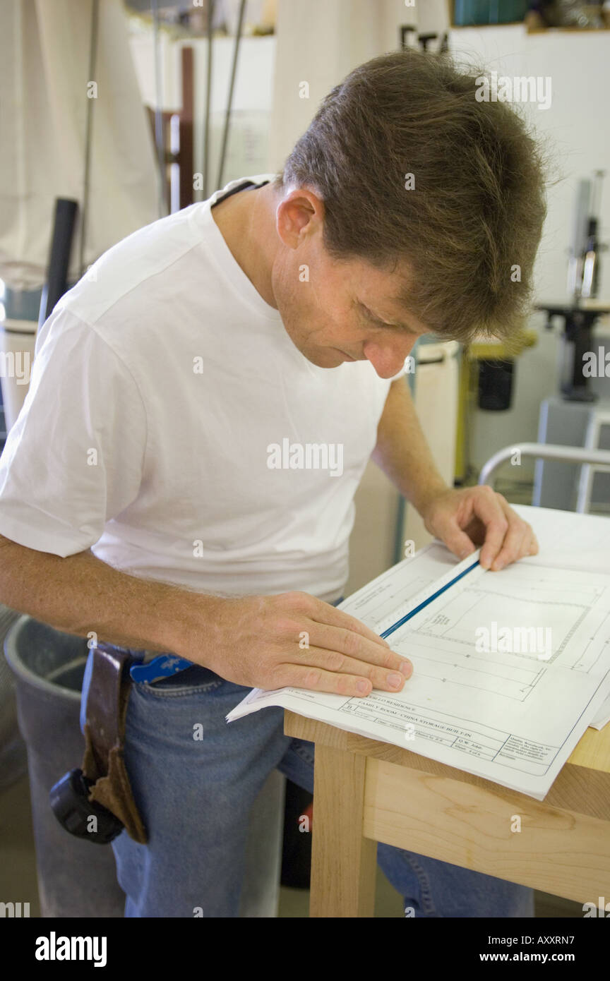 Business owner regular job woodworking cabinet maker man working business owner regular job woodworking cabinet maker man working self employed people person at work plans blueprints measuring malvernweather Image collections