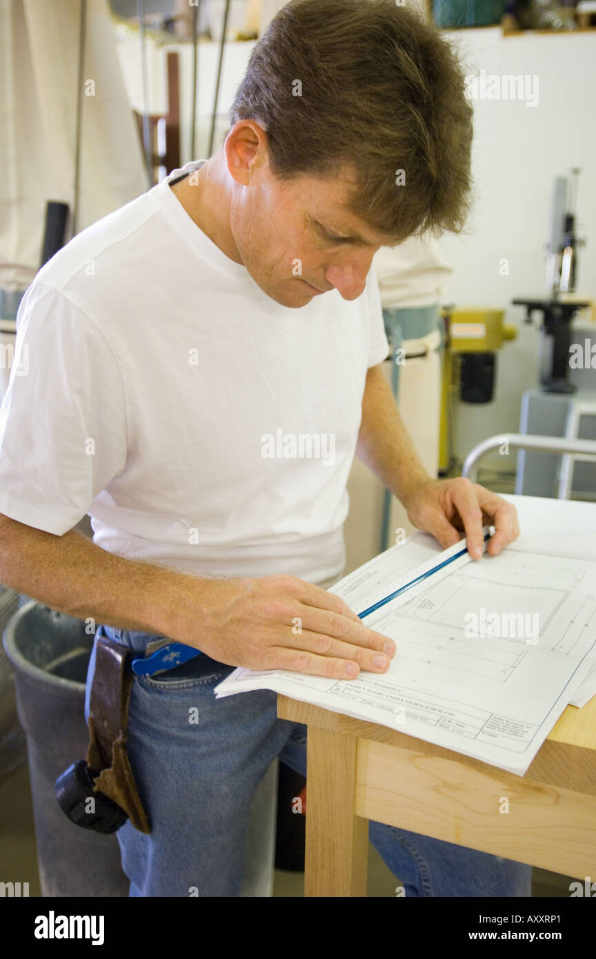 Business owner regular job woodworking cabinet maker man working business owner regular job woodworking cabinet maker man working self employed people person at work plans blueprints measuring malvernweather Gallery