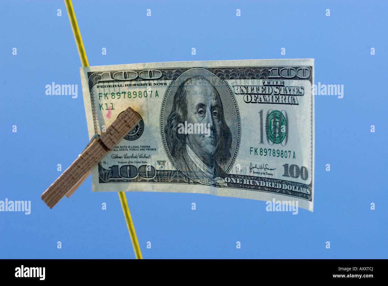 hundred dollar bill drying on a washing line - Stock Image