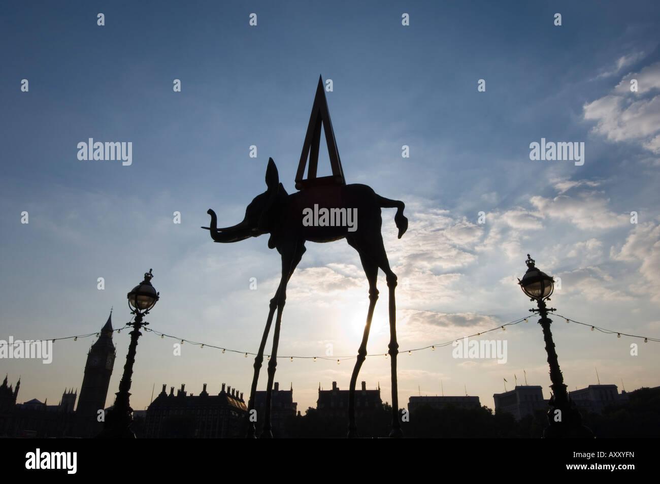 Dali elephant sculpture silhouette with Westminster skyline beyond, London, England, United Kingdom, Europe - Stock Image